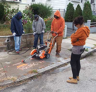 Cutting away a section of the sidewalk.